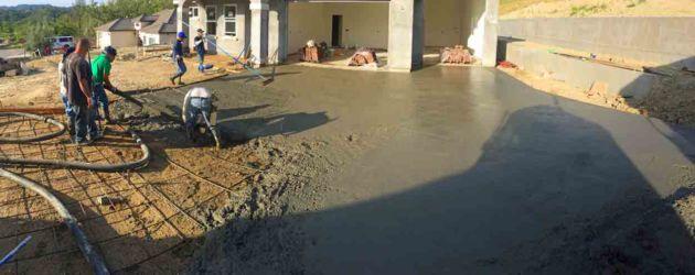 Pouring concrete into driveway