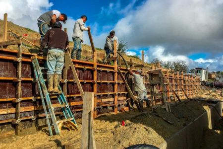 Pouring concrete into retaining wall form